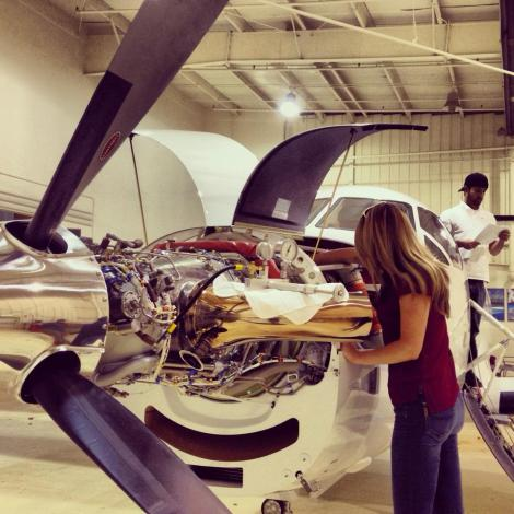 Amelia working on a Pilatur aircraft (photo provided by Amelia Earhart)
